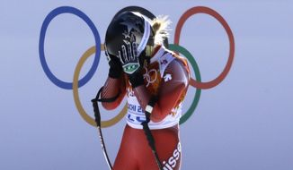 Switzerland's Lara Gut reacts after finishing the women's downhill at the Sochi 2014 Winter Olympics, Wednesday, Feb. 12, 2014, in Krasnaya Polyana, Russia. (AP Photo/Kirsty Wigglesworth)