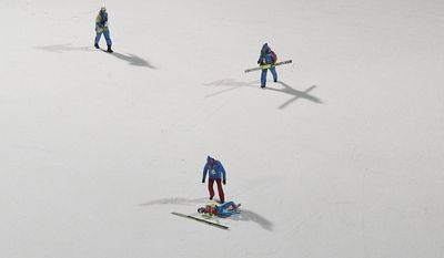 Russia's Mikhail Maksimochkin lies on the ground after falling during a men's ski jumping large hill training session at the 2014 Winter Olympics, Wednesday, Feb. 12, 2014, in Krasnaya Polyana, Russia. (AP Photo/Matthias Schrader)
