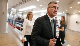 Sen. John Walsh, Montana Democrat, cast a vote in favor of raising the debt ceiling in his first full day on the job on Wednesday. (Associated Press)