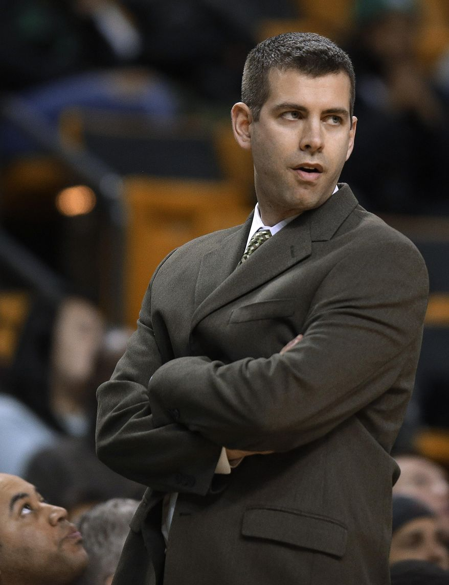 Boston Celtics coach Brad Stevens watches as his team plays defense against the San Antonio Spurs during the first half of an NBA basketball game in Boston, Wednesday, Feb. 12, 2014. (AP Photo/Stephan Savoia)