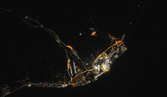 This Feb. 8, 2014 photo, provided by NASA, shows the site of the 2014 Winter Olympics at night, in Sochi, Russia. Fisht Stadium where the opening ceremony was held on Friday, Feb. 7, 2014, is the bright circular structure.  (AP Photo/NASA)