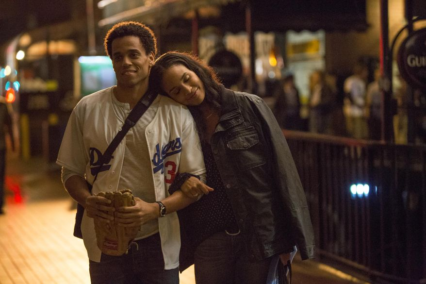 """This image released by Sony Pictures shows Michael Ealy, left, and Joy Bryant in a scene from """"About Last Night."""" (AP Photo/Sony Pictures, Matt Kennedy)"""