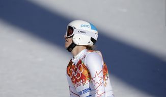 United States' Julia Mancuso reacts after finishing the women's downhill at the Sochi 2014 Winter Olympics, Wednesday, Feb. 12, 2014, in Krasnaya Polyana, Russia. (AP Photo/Gero Breloer)