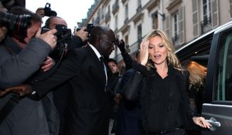 """FILE - In this Nov. 21, 2012 file photo, British model Kate Moss arrives at a bookshop in Paris for a book signing event. Swiss snowboarder Iouri Podladtchikov mentioned the supermodel three times during a news conference on Wednesday, Feb. 12, 2014, one day after winning the gold medal in the halfpipe at the Winter Olympics in Sochi, Russia. """"I am big into photography,"""" said Podladtchikov. """"It is a big dream to take a photo of Kate Moss."""" (AP Photo/Thibault Camus, File)"""