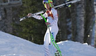 United States' Ted Ligety leaves after a men's supercombined downhill training run at the Sochi 2014 Winter Olympics, Wednesday, Feb. 12, 2014, in Krasnaya Polyana, Russia. (AP Photo/Gero Breloer)