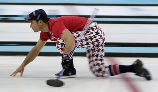 Norway's skip Thomas Ulsrud slides across the ice as he watches his throw during men's curling competition against Germany at the 2014 Winter Olympics, Wednesday, Feb. 12, 2014, in Sochi, Russia. (AP Photo/Robert F. Bukaty)