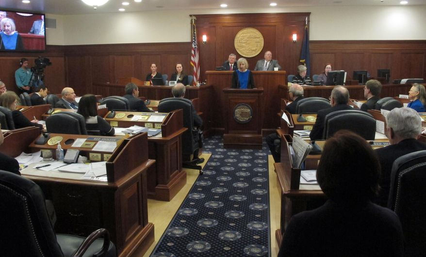 Dana Fabe, the chief justice of the Alaska Supreme Court, delivers the State of the Judiciary address to a joint session of the Alaska Legislature on Wednesday, Feb. 12, 2014, in Juneau, Alaska. (AP Photo/Becky Bohrer)
