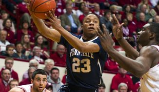 Penn State's Tim Frazier (23) passes the ball to a teammate from under the basket in the first half of an NCAA college basketball game against Indiana, Wednesday, Feb. 12, 2014, in Bloomington, Ind. (AP Photo/Doug McSchooler)