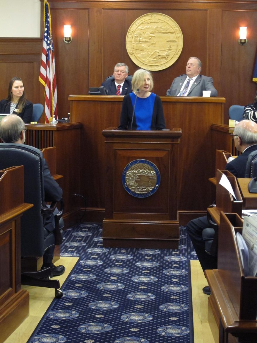 Dana Fabe, the chief justice of the Alaska Supreme Court, delivers the State of the Judiciary address to a joint session of the Alaska Legislature on Wednesday, Feb. 12, 2014, in Juneau, Alaska. Shown behind her as Senate President Charlie Huggins, left, and House Speaker Mike Chenault, right. (AP Photo/Becky Bohrer)