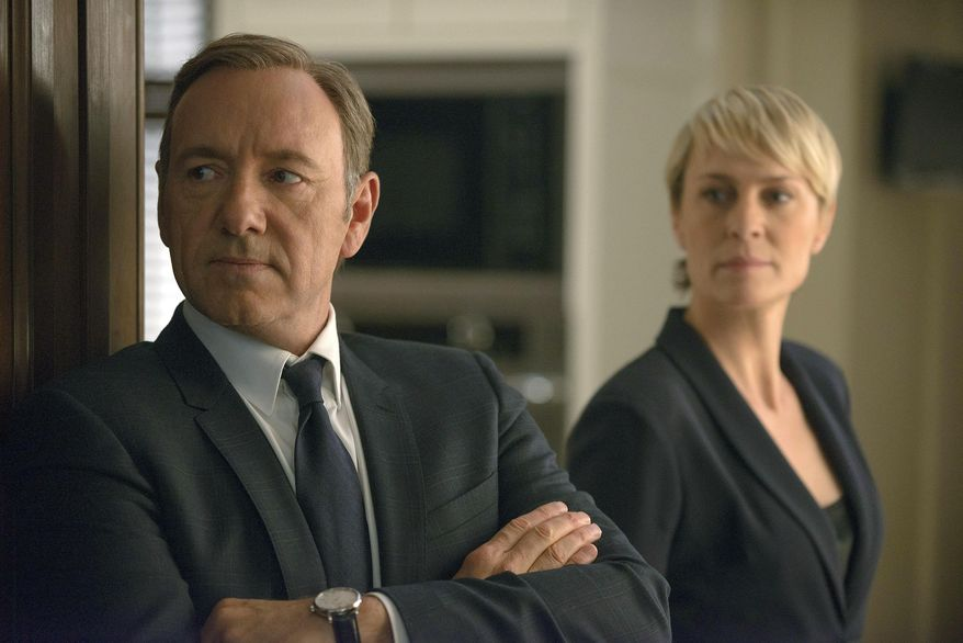 """This image released by Netflix shows Kevin Spacey as Francis Underwood, left, and Robin Wright as Clair Underwood in a scene from """"House of Cards."""" The second season of the popular original series premieres on Friday, Feb. 14, 2014 on Netflix. (AP Photo/Netflix, Nathaniel E. Bell)"""