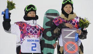 Men's snowboard halfpipe silver medalist Ayumu Hirano of Japan, left, and bronze medalist Taku Hiraoka, alson Japan, pose on the podium at the Rosa Khutor Extreme Park, at the 2014 Winter Olympics, Tuesday, Feb. 11, 2014, in Krasnaya Polyana, Russia.   (AP Photo/Andy Wong)