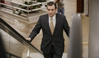 Sen. Ted Cruz, R-Texas arrives on Capitol Hill in Washington, Wednesday, Feb. 12, 2014, as senators go to the chamber for a vote to extend the Treasury's borrowing authority. Congress appears on track to send President Barack Obama must-do legislation to extend Treasury's borrowing authority without any concessions from the White House. (AP Photo/J. Scott Applewhite)