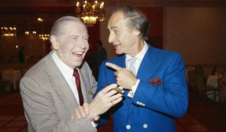 FILE - This April 15, 1986 file photo shows comedians Milton Berle, left, and Sid Caesar prior to Caesar's roast in Beverly Hills, Calif. Caesar, whose sketches lit up 1950s television with zany humor, died Wednesday, Feb. 12, 2014. He was 91.  (AP Photo/Michael Tweed, File)