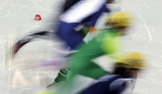 Skaters compete during a women's 500m short track speedskating race at the 2014 Winter Olympics, Monday, Feb. 10, 2014, in Sochi, Russia. (AP Photo/Morry Gash)