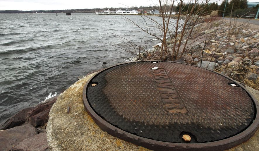 FILE - In this Dec. 5, 2012 file photo, a sewer cover is seen along the shore of Lake Champlain in Burlington, Vt. In a hearing Wednesday, Feb. 12, 2014, Vermont Environmental Conservation Commissioner David Mears outlined a proposal where the state would enhance water quality rules to limit non-wastewater runoff into Lake Champlain. (AP Photo/Toby Talbot, File)
