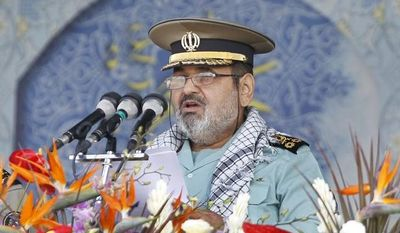 **FILE** Gen. Hasan Firouzabadi (center), chief of the General Staff of Iran's Armed Forces, delivers a speech as Revolutionary Guard commander Mohammad Ali Jafari (right) and army commander Ataollah Salehi listen during Armed Forces parade just outside Tehran on Sept. 22, 2011, marking the 31st anniversary of the start of the Iraq-Iran war, in front of the mausoleum of the late Iranian revolutionary founder Ayatollah Khomeini. (Associated Press)