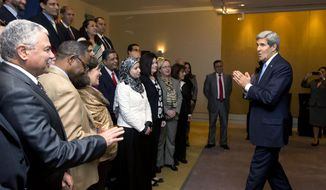 **FILE** U.S. Secretary of State John Kerry, right, speaks with U.S. embassy staff workers after a joint press conference in Cairo, Sunday, Nov. 3, 2013.  (AP Photo/Jason Reed, Pool)
