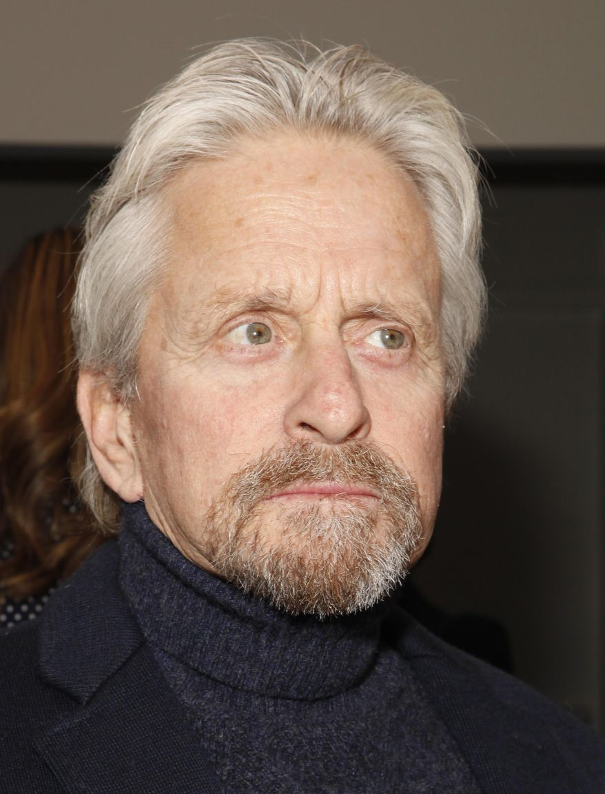 Actor Michael Douglas attends the Michael Kors 2014 Fall/Winter Collection during Mercedes Benz Fashion Week on Wednesday, Feb. 12, 2014, in New York. (Photo by Amy Sussman/Invision/AP)