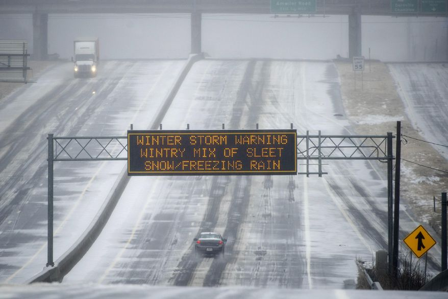A Georgia Department of Transportation sign warns drivers of winter weather as they travel a bleak section of Highway 141 on Wednesday, Feb. 12, 2014, in Norcross, Ga. The scene is the opposite of what drivers experienced two weeks ago when every major artery of metropolitan Atlanta was clogged during the last winter storm. (AP Photo/John Amis)