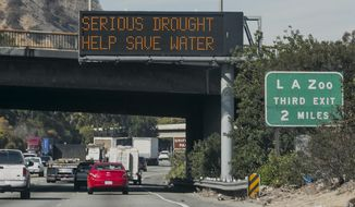 "A road sign reads: ""Serious Drought Help Save Water"" on Interstate 5 in Los Angeles Wednesday, Feb. 12, 2014.  Calif. Gov. Jerry Brown has formally proclaimed California in drought emergency, calling on Republicans and Democrats in Congress to compromise on legislation to help the state's drought-stricken agricultural heartland. (AP Photo/Damian Dovarganes)"