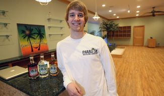 In this Feb. 11, 2014 photo, Nick Berger poses for a photo at Paradise Distilling Company in Deubuque, Iowa. Joe Berger, 50, and three adult children, including Nick, are opening the doors to Paradise Distilling Co. on March 1, the Telegraph Herald reported. (AP Photo/The Telegraph Herald, Jessica Reilly)