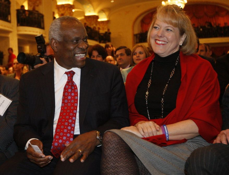 ** FILE ** Supreme Court Justice Clarence Thomas with his wife, Virginia Thomas. (Associated Press)