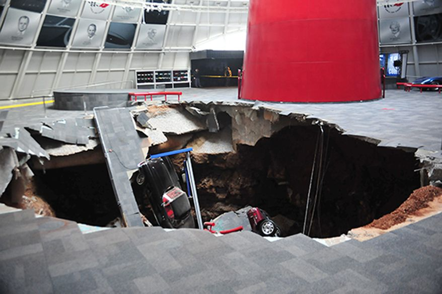 Several cars collapsed into a sinkhole on Feb. 12 at the National Corvette Museum in Bowling Green, Ky. The museum said a total of eight cars were damaged when the sinkhole opened up inside the museum. (Associated Press/National Corvette Museum)