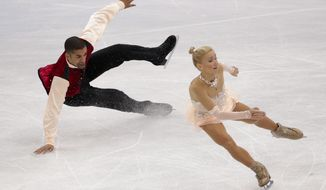 Robin Szolkowy falls as he and Aliona Savchenko of Germany compete in the pairs free skate figure skating competition at the 2014 Winter Olympics, Wednesday, Feb. 12, 2014, in Sochi, Russia. (AP Photo/Bernat Armangue)