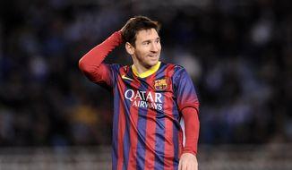 FC Barcelona's Lionel Messi of Argentina, gestures during their Spanish Copa del Rey semifinal second leg soccer match against Real Sociedad, at Anoeta stadium, in San Sebastian northern Spain, Wednesday, Feb. 12, 2014. (AP Photo/Alvaro Barrientos)
