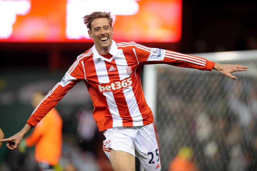 Stoke's Peter Crouch celebrates after scoring against Swansea during the English Premier League soccer match between Stoke City and Swansea City at Britannia Stadium in Stoke On Trent, England, Wednesday, Feb. 12, 2014.  (AP Photo/Rui Vieira)