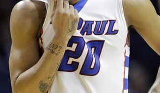 DePaul guard Brandon Young wipes his face during the second half of an NCAA college basketball game against Villanova in Rosemont, Ill., Wednesday, Feb. 12, 2014. Villanova won 87-62. (AP Photo/Nam Y. Huh)