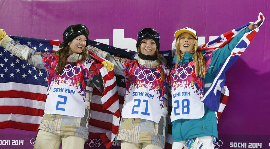From left, bronze medalist United States' Kelly Clark, gold medalist United States' Kaitlyn Farrington and silver medalist Australia's Torah Bright pose following the women's snowboard halfpipe at the Rosa Khutor Extreme Park, at the 2014 Winter Olympics, Wednesday, Feb. 12, 2014, in Krasnaya Polyana, Russia. (AP Photo/Sergei Grits)