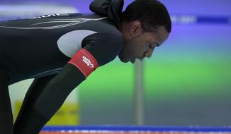 Shani Davis of the U.S. takes a breather after competing in the men's 1,000-meter speedskating race at the Adler Arena Skating Center during the 2014 Winter Olympics in Sochi, Russia, Wednesday, Feb. 12, 2014. (AP Photo/Matt Dunham)