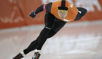 Stefan Groothuis of the Netherlands competes in the men's 1,000-meter speedskating race at the Adler Arena Skating Center during the 2014 Winter Olympics in Sochi, Russia, Wednesday, Feb. 12, 2014. (AP Photo/Pavel Golovkin)