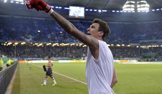 Bayern's Mario Mandzukic of Croatia points to his fans after scoring three goals in the  quarterfinal match of the German soccer cup between Hamburger SV and Bayern Munich in Hamburg, Germany, Wednesday, Feb. 12, 2014. (AP Photo/Martin Meissner)