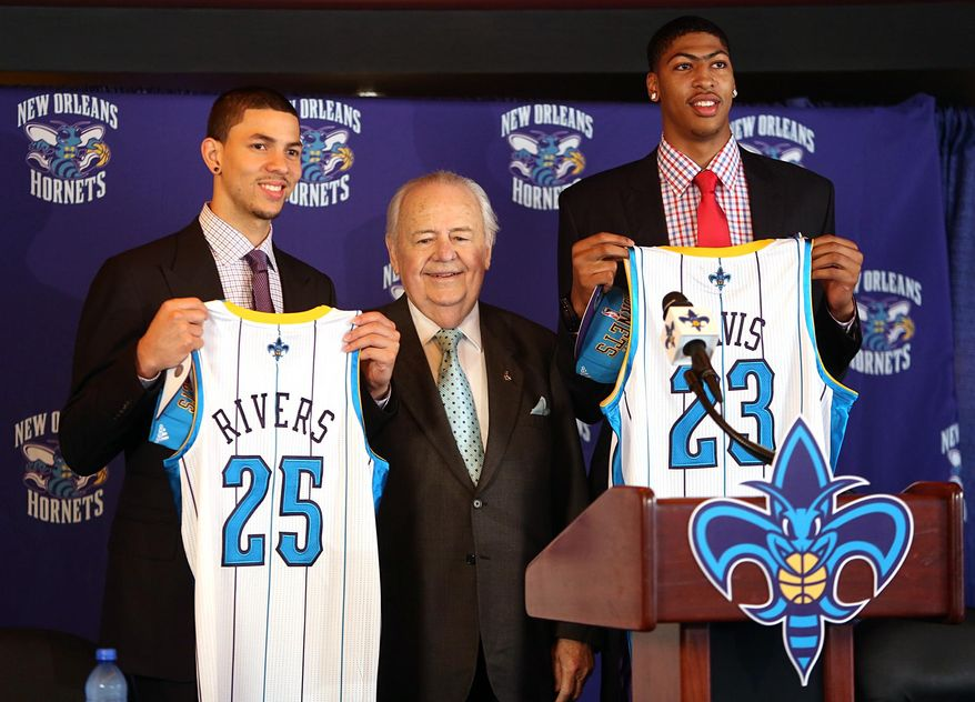 FILE - In this June 29, 2012 file photo, New Orleans Hornets NBA basketball team owner Tom Benson is flanked by 2012 draft picks Austin Rivers, left, and Anthony Davis in New Orleans. One of the people most responsible for bringing NBA All-Stars back to the Big Easy this weekend is an 86-year-old man who wasn't that into basketball for much of his life. He is Tom Benson. And in New Orleans, NBA fans and community leaders are grateful the Pelicans owner finally came around. (AP Photo/Kerry Maloney, File)