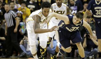 VCU's Juvonte Reddic, left, goes after a loose ball on a turnover by George Washington's John Kopriva during the first half of their Atlantic 10 NCAA college basketball game in Richmond, Va., on Wednesday, Feb. 12, 2014. (AP Photo/ Richmond Times-Dispatch, Dean Hoffmeyer)