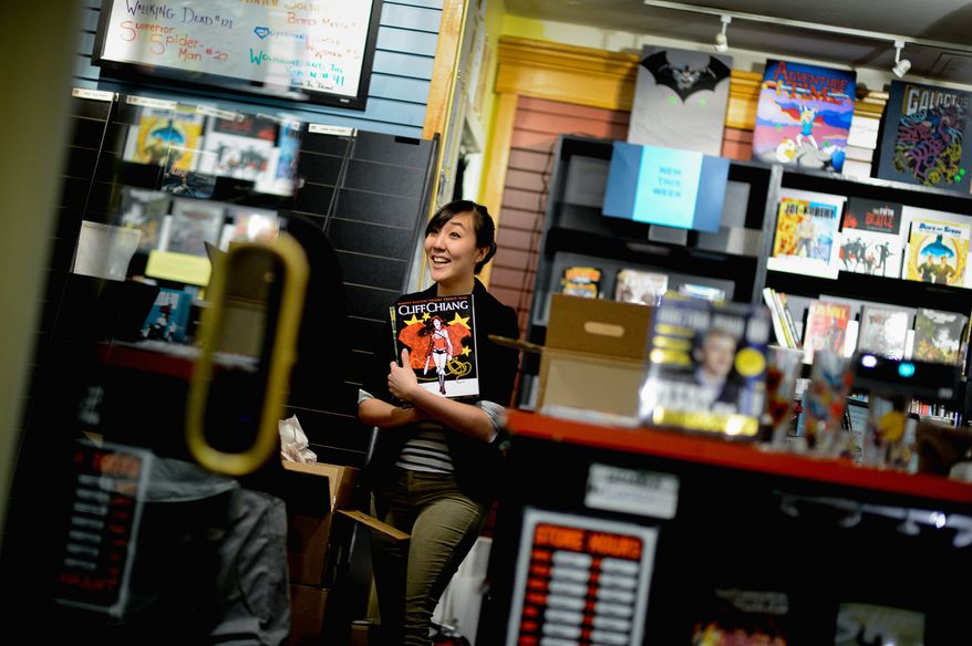 "A funny thing happened: ""As much as I want money for the store, I really want ladies into comics,"" says Esther Kim, manager at Fantom Comics in Union Station. (Andrew Harnik/The Washington Times)"