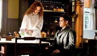 "Jessica Brown Findlay as Beverly Penn and Colin Farrell as Peter Lake in a scene from ""Winter's Tale,"" directed by Akiva Goldsman. (ASSOCIATED PRESS)"