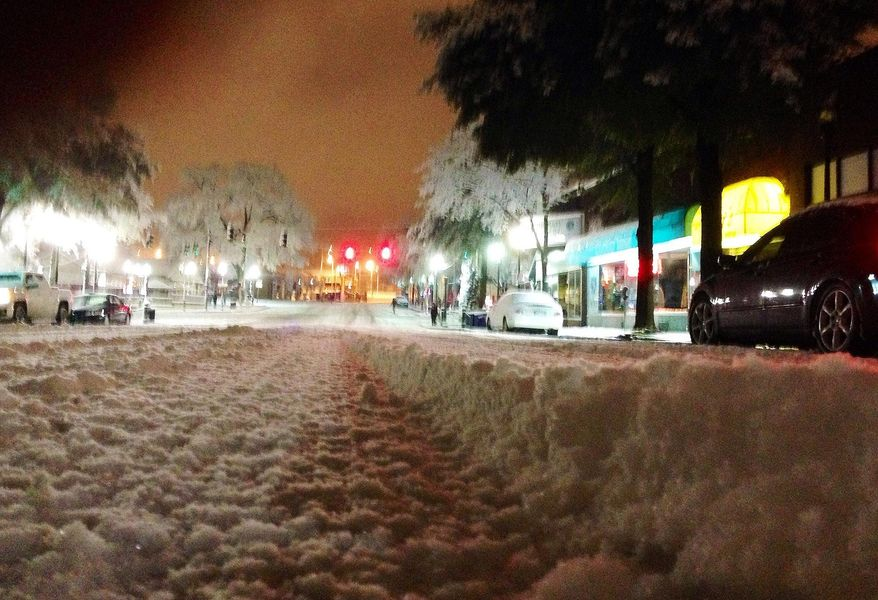 Snow blankets a street in downtown Birmingham, Ala., on Wednesday, Feb. 12, 2014. Snow and ice covered the northern half of the state, forcing authorties to close roads and prompting another day of school and business closings. (AP Photo/Jay Reeves)