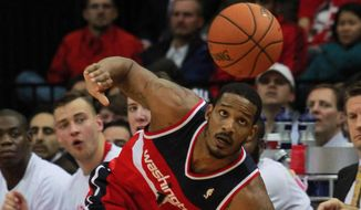 Washington Wizards forward Trevor Ariza chases a loose ball during play against the Houston Rockets in the second half of an NBA basketball game in Houston, Wednesday, Feb. 12, 2014. (AP Photo/Richard Carson)