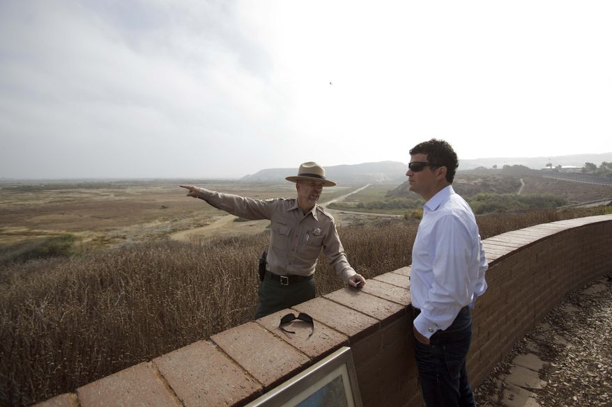 **FILE** State Field State Park Director Clay Phillips talks with Jared Blumenfeld, regional administrator of the Environmental Protection Agency, during a tour of the park just north of the border with Mexico Wednesday, Sept. 21, 2011, in San Diego. (AP Photo/Gregory Bull)