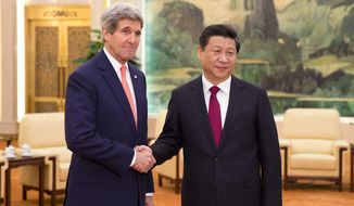 ** FILE ** U.S. Secretary of State John Kerry, left, meets with Chinese President Xi Jinping at the Great Hall of the People in Beijing, China Friday, Feb. 14, 2014. Kerry is meeting senior Chinese officials on Friday in Beijing to seek their help in bringing a belligerent North Korea back to nuclear disarmament talks. (AP Photo/Evan Vucci, Pool)