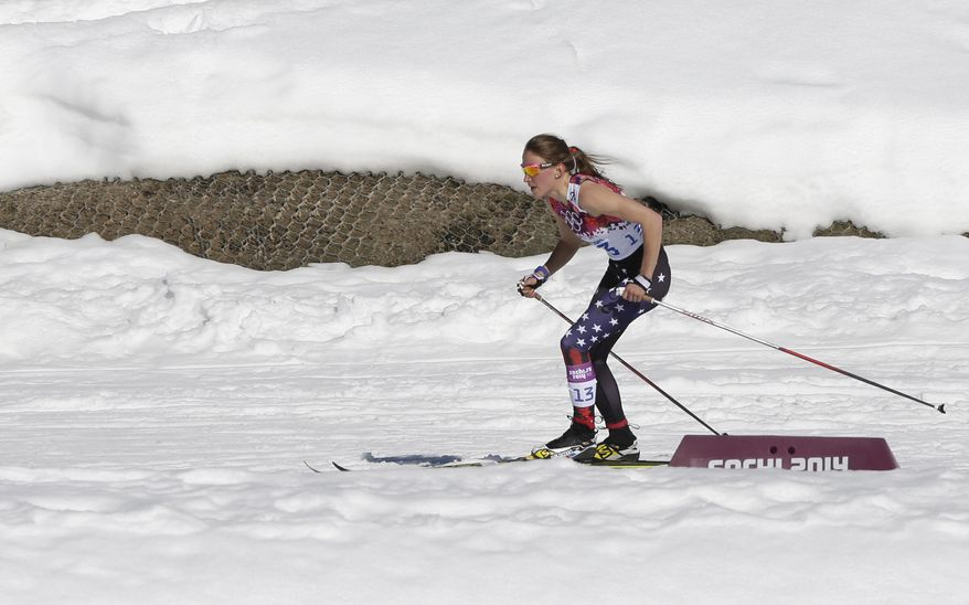 Sophie Caldwell of the United States skis with a sleeveless top as temperatures go well over the freezing point during the women's 10K classical-style cross-country race at the 2014 Winter Olympics, Thursday, Feb. 13, 2014, in Krasnaya Polyana, Russia. (AP Photo/Matthias Schrader)