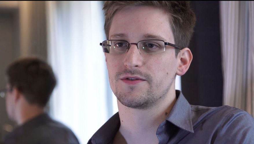 This June 9, 2013 photo provided by The Guardian Newspaper in London shows Edward Snowden in Hong Kong. The National Security Agency is telling Congress that an agency employee resigned after admitting to investigators that he gave Snowden a digital key that allowed him access to classified materials. Snowden has said he did not steal any passwords. (AP Photo/The Guardian, Glenn Greenwald and Laura Poitras)