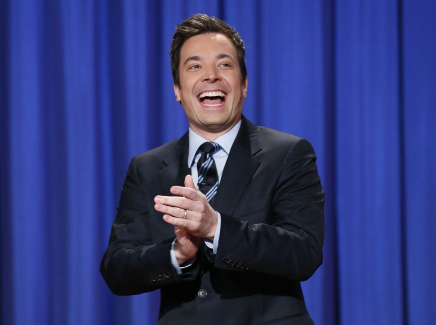 """** FILE ** This April 4, 2013, file photo released by NBC shows Jimmy Fallon, host of """"Late Night with Jimmy Fallon,"""" in New York.  Fallon will debut as host of his new show, """"The Tonight Show with Jimmy Fallon,"""" on Feb. 17. (AP Photo/NBC, Lloyd Bishop, File)"""