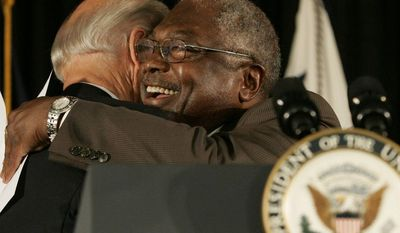**FILE** Vice President Joseph R. Biden gets a hug from Rep. Jim Clyburn, South Carolina Democrat, during the dedication ceremony of the new Ernest F. Hollings Special Collections Library in Columbia, S.C., on July 23, 2010. (Associated Press)