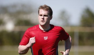 Washington Nationals relief pitcher Drew Storen runs as he timed during a spring training baseball workout, Friday, Feb. 14, 2014, in Viera, Fla. (AP Photo/Alex Brandon)
