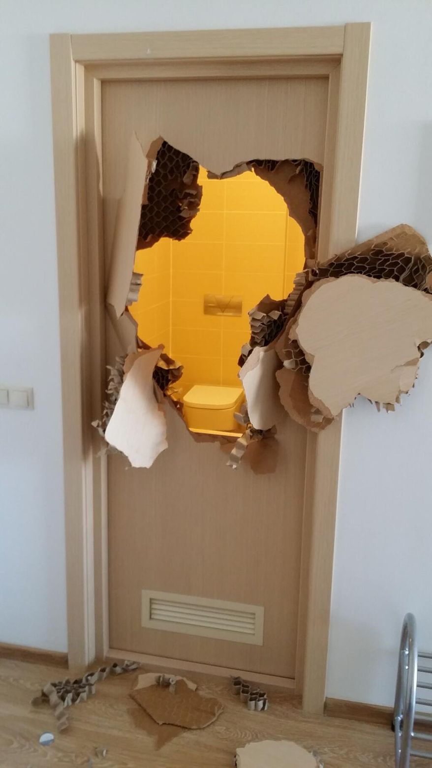 This photo provided by bobsledder Johnny Quinn of the United States shows a door he broke through after realizing he was locked in a bathroom inside the athlete's village, during the 2014 Winter Olympics, in Sochi, Russia. An unknown during stints in the NFL with Green Bay and Buffalo, Quinn literally burst onto the world's stage last week after he tweeted the photo on Feb. 8, 2014.  (AP Photo/Johnny Quinn)