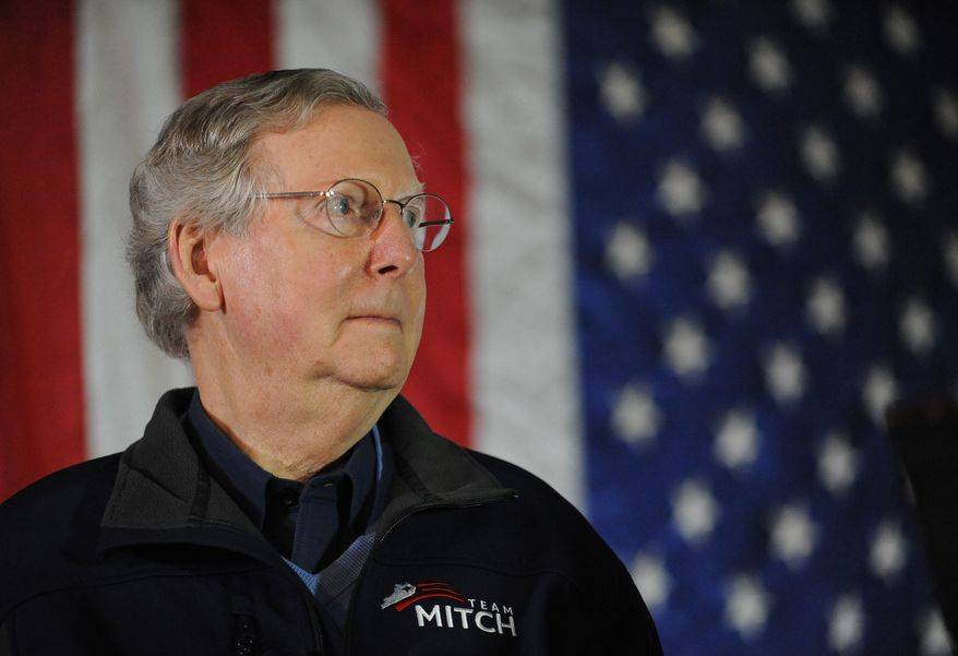 **FILE** Senate Minority Leader Mitch McConnell, Kentucky Republican, waits to speak during a campaign stop at Badgett Supply in Madisonville, Ky., on Feb. 8, 2014. (Associated Press)